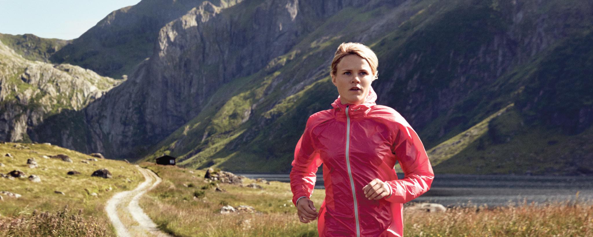 Lady running in Helly Hansen clothing